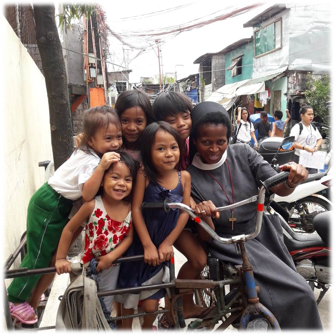 phil sr lydia with children on tricycle